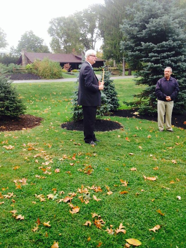 Man speaking at park for Peg Castina dedication